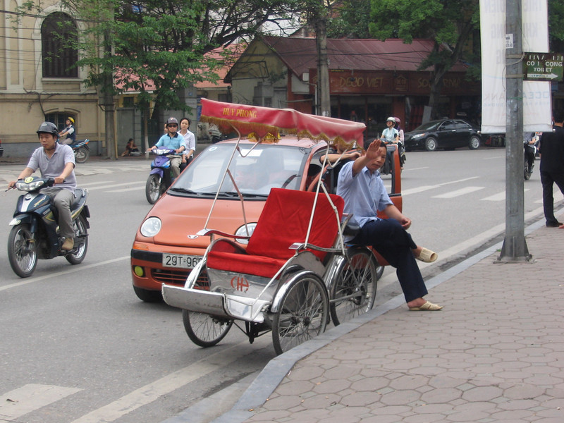 "The ever present ""Cyclo"". They are everywhere in Hanoi's old quarter, constantly looking for tourists. They will follow you down the street, asking if you want a ride."