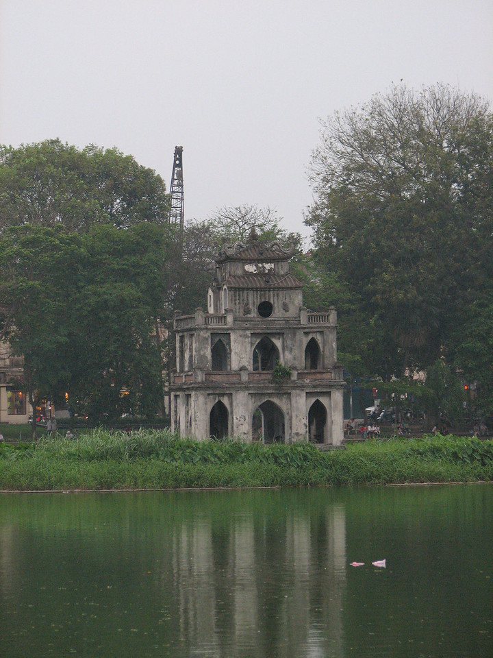 The Tortoise Tower standing on a small island near the center of Hoan Kiem lake.
