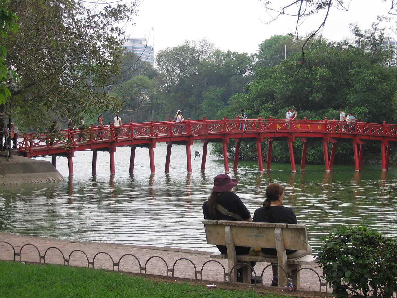 "Hoan Kiem Lake, the center of old Hanoi. The bridge leads to an island and a temple dedicated to the legend of the lake. More Info <a href=""http://en.wikipedia.org/wiki/Hoan_Kiem_Lake"">http://en.wikipedia.org/wiki/Hoan_Kiem_Lake</a>"