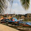 The Hoi An harbor with fishing boats at their moorings.