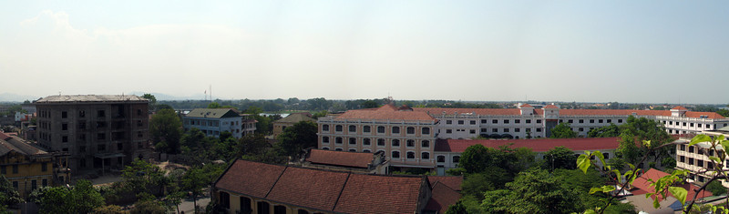 Hue, in central Vietnam just below the former DMZ. This is looking out of the deck of our hotel room over the Perfume River and the citadel of the old capitol. The royal tombs of previous emperors are scattered around the countryside.