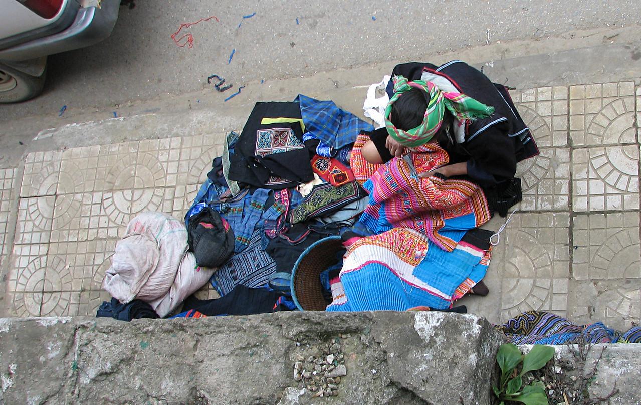 Hmong women setup their wares on the street.