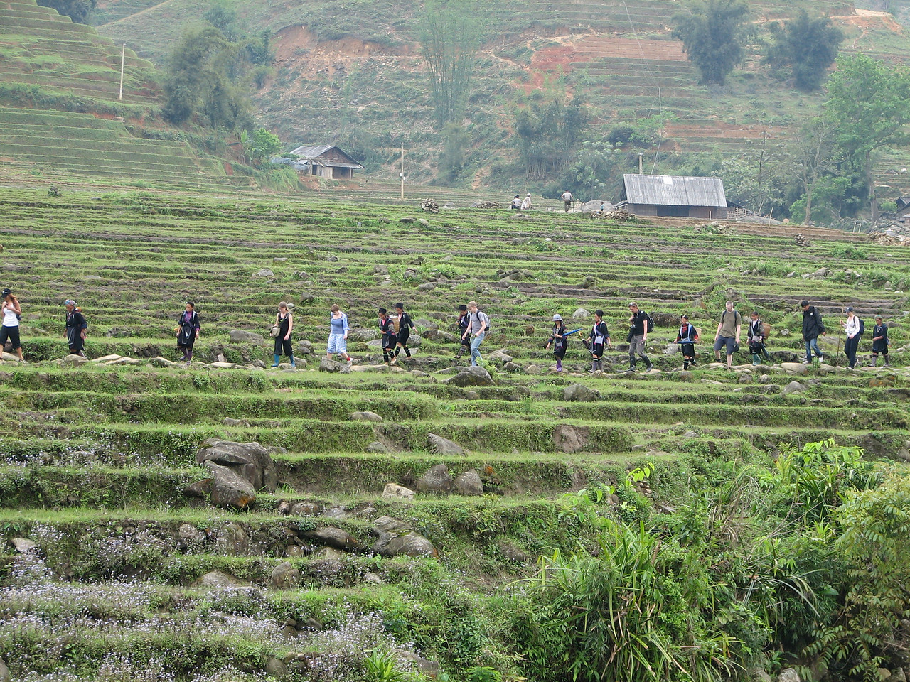 Each group of hikers had their Hmong followers who would help them along the way and then offer to sell them goods at the end of the trip.