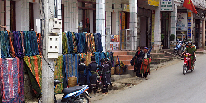 Hmong ladies lay out their wares in the street.