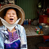 Traditional Vietnamese lady shares a laugh
