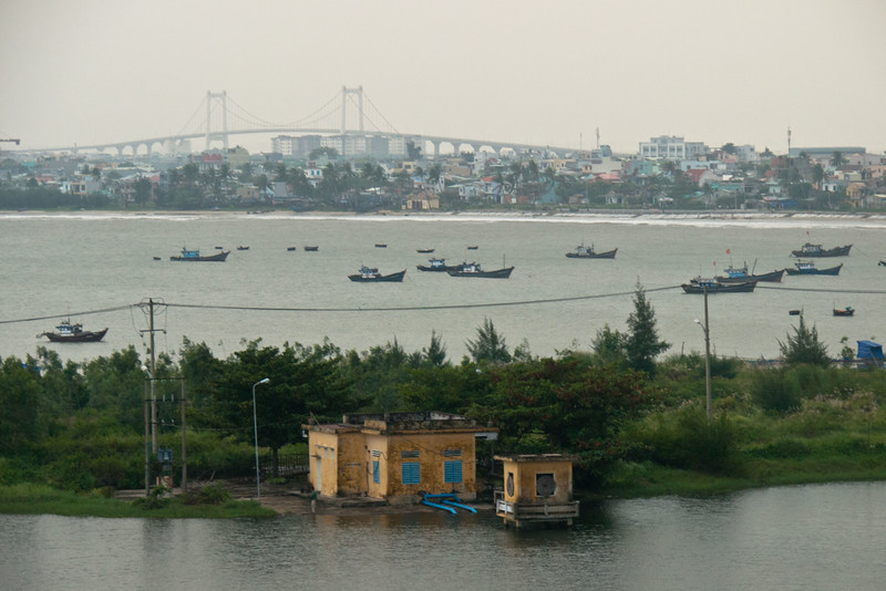 A view from the bluff over a small lake and then behind it China Beach and Danang.