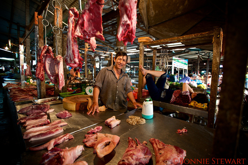 Meat vendor in the village market of Can Tho