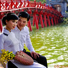 A Bride and Groom in front of the Sunbeam Bridge, or The Huc, on the Hoan Kiem Lake in Hanoi