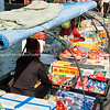 """Floating vendors in Halong Bay. The plaintive cry """"buy something sir"""" as you walk by is hard to resist."""