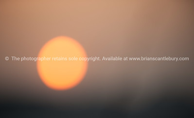 The sun, at sunset in the Vietnam sky. Vietnam travel images and stock photos.
