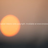The sun, at sunset in the Vietnam sky.<br /> Vietnam travel images and stock photos.