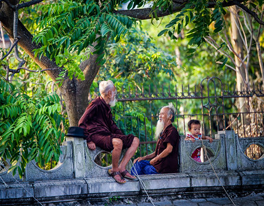 Old men and young girl on the bank of the Ngo Dong River.