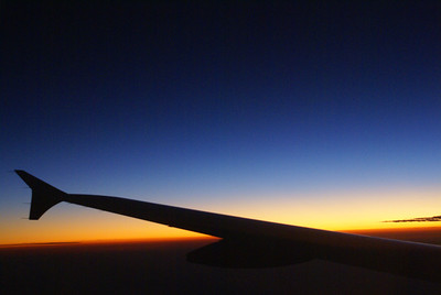 Plane flight at dusk