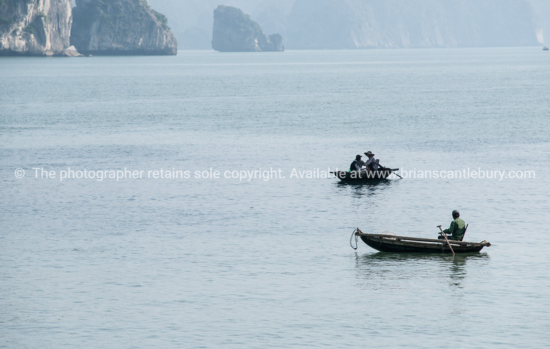 """Villagers fishing in Halong Bay.<br />  """"Descending dragon bay"""" is a UNESCO World Heritage Site,"""