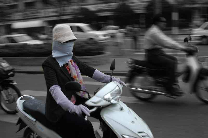 in Vietnam, it so turns out that immigration is coming from dark skinned countries (Burma, Nepal, India). To keep their pride, the Vietnamese are absolutely passionate about protecting their skin from sun light, to prove they are not immigrants but white skinned. That is the reason why they have the masks, and the long arm gloves.