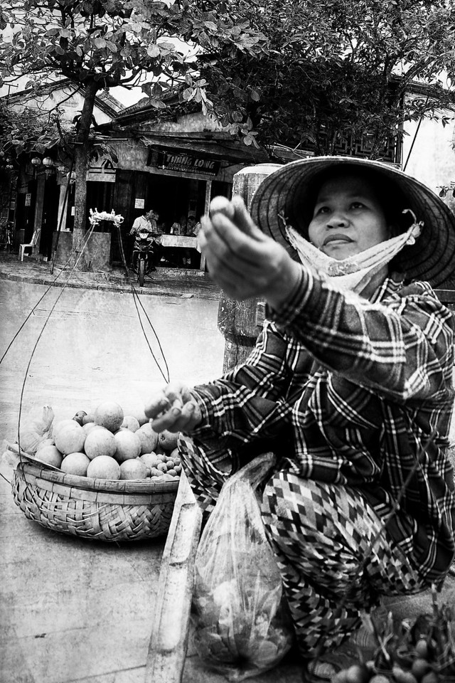 A lady selling fruit in Hue.