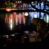 A local sells some snacks on the waterfront in the ancient town in Hoi An.