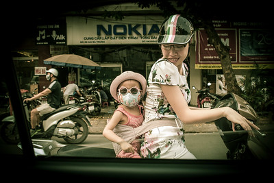 Mother and Child on Scooter - Hanoi, Vietnam