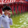 A Bride in front of the Sunbeam Bridge, or The Huc, on the Hoan Kiem Lake in Hanoi