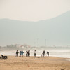 Fishermen on China Beach with Danang in the background.