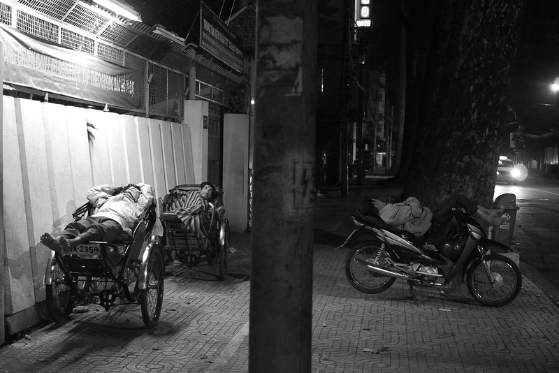 Time for bed.  I remember these cyclo drivers from a few evenings ago  I'm not sure how much driving they do - they were asleep when I saw them last time too!