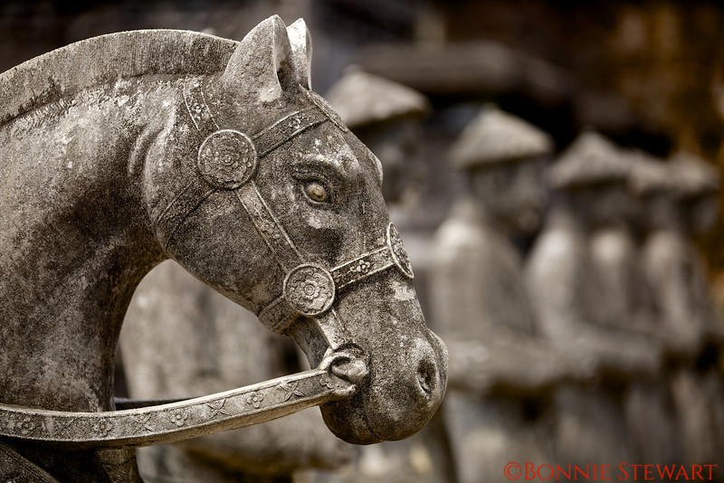 Close-up of the Horses carved in granite with the Emperor's men in the background of the Nguyen Emperor, Khai Dinh