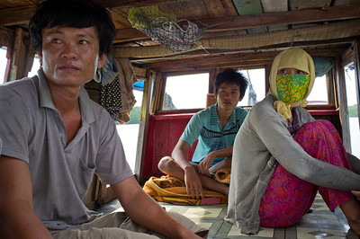 Family on fishingboat trawling the riverbed