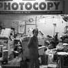 There are many Photocopy shops around that are open late into the night.  Often with half a dozen staff busily printing and binding booklets.