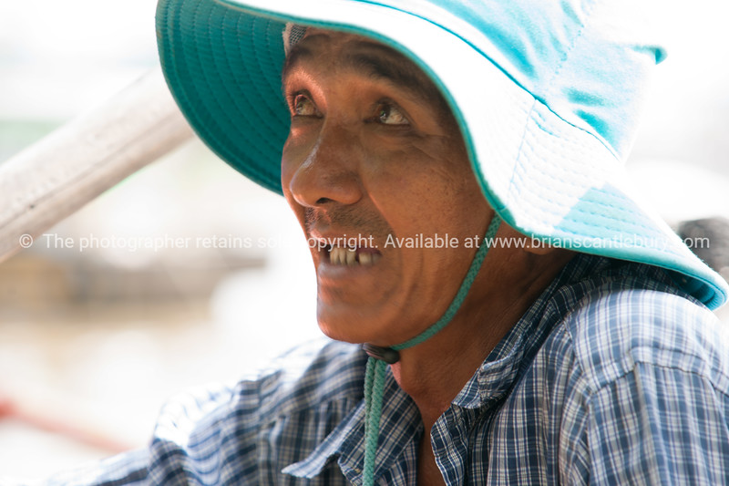 Man in blue hat, closeup. Vietnam travel images and stock photos.