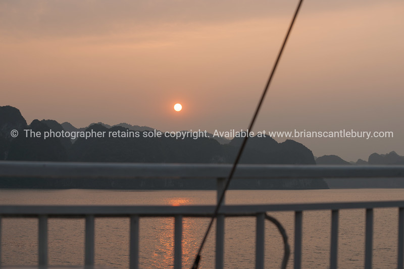 """Halong Bay setting sun. <br />  """"Descending dragon bay"""" is a UNESCO World Heritage Site,Vietnam travel images and stock photos."""