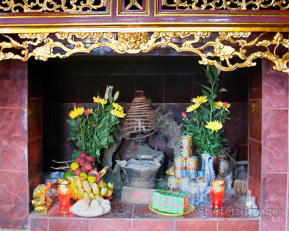 Offering at a Buddhist temple includes Hanoi Beer