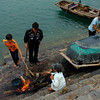 Sealing the boat.<br /> Catba Island,<br /> Ho long Bay, Vietnam