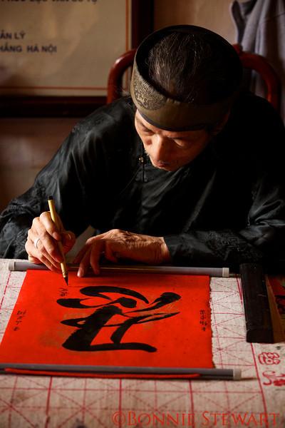 Calligrapher in the Jade Mountain Temple, across the Sunbeam Bridge in Hoan Kiem Lake, Hanoi