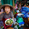 Market lady eating Pho
