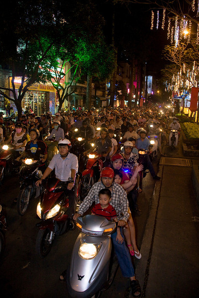 Imagine if all those bikes were cars. First of all, these people would look really silly sitting on top of their cars, but also it might be a little more congested. Ho Chi Minh City (Saigon).