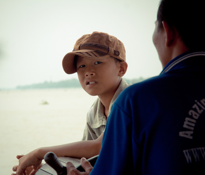 'Boat boy in Vietnam' - A thoughtful, intense look by a boy who works on a boat in the Meekon Delta in Vietnam.