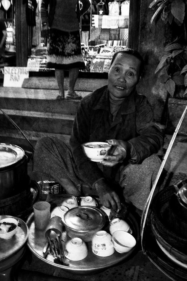 A hopeful food vendor. Hoi An.