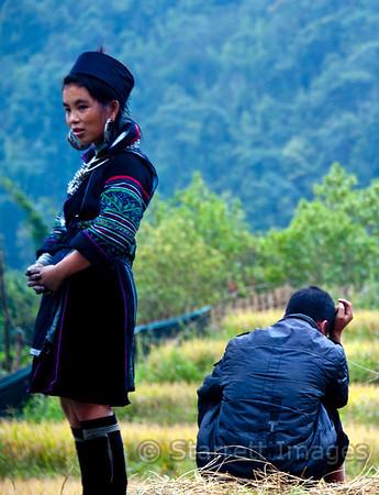 Black H'mong girl waits for her inebriated husband