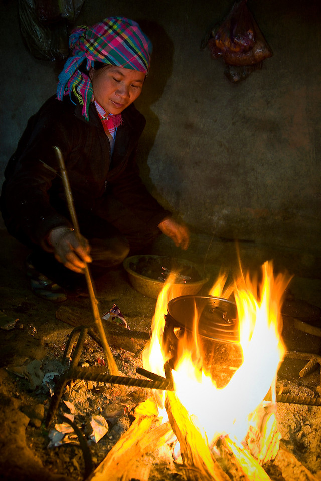 The matriarch of the family we stayed with in the Sapa Mountains prepares our dinner.