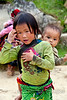 Every small girl in Vietnam seems to be carrying her younger sibling