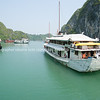 """Halong Bay, cruise vessels amongst the limestone rock islets.<br />  """"Descending dragon bay"""" is a UNESCO World Heritage Site,"""