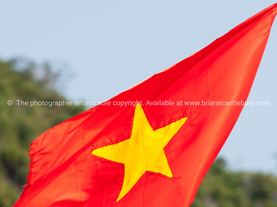Vietnam flag, red background with yellow star. Vietnam travel images and stock photos.