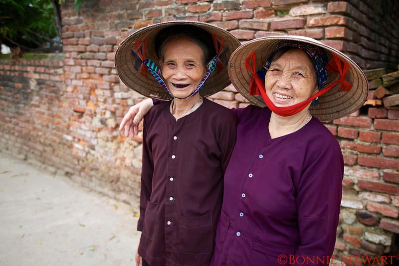 Two village elders - one who ate too many beetle nuts (notice the black teeth)