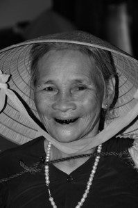 A woman with blackened teeth, from betel nut use.