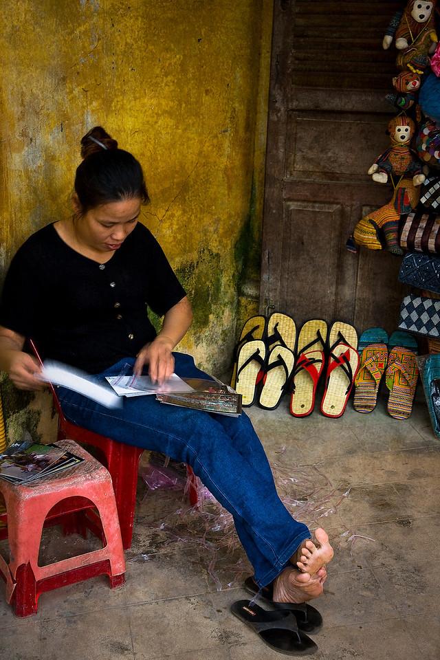 A sandal vendor takes a load off. Hoi An.