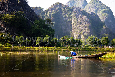 Fishing on Ngo Dong river at Tam Coc