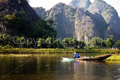 Fishing on Ngo Dong river at Tam Coc