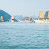 """Cruise vessel and junks amongst the limestone islets in Halong Bay in October 2013.<br />  """"Descending dragon bay"""" is a UNESCO World Heritage Site,"""