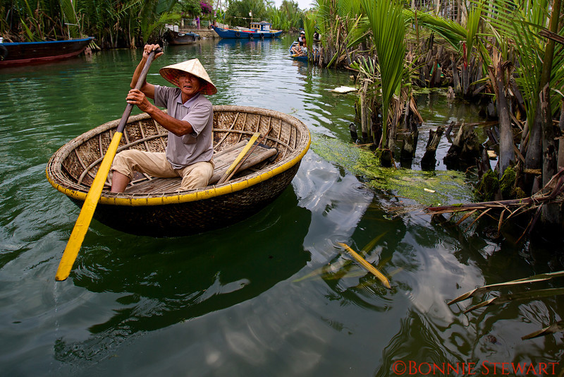 Rowing a bamboo boat