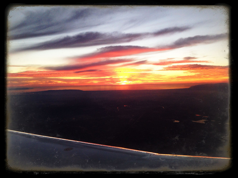 Sun setting over LA en route to SFO